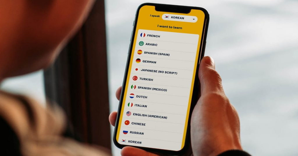 an image of a man holding the memrise app