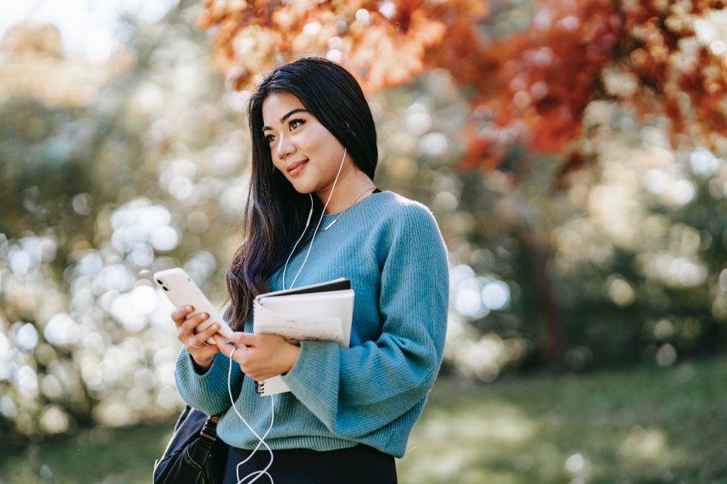 Image of woman using phone to access app