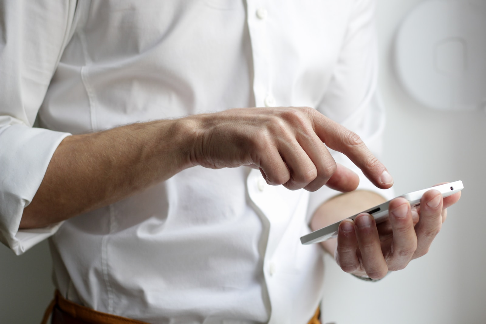 person holding phone to search for best language learning app